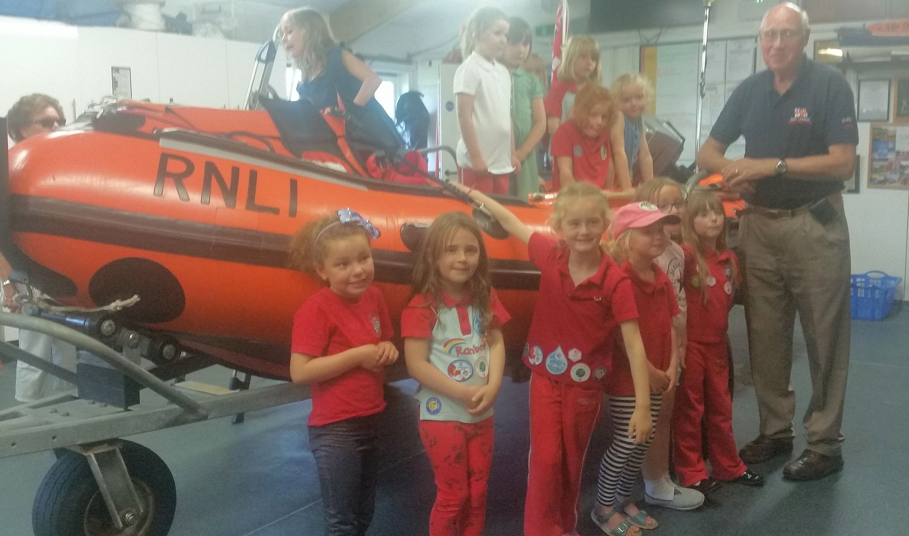 The Rainbows took it in turn to climb into the D class lifeboat